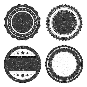 Cuatro diferentes insignias de grunge, sello de círculo de estilo antiguo.