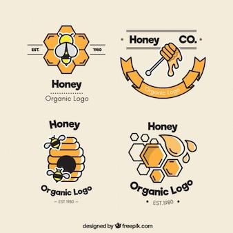 Cuatro logotipos de miel, estilo plano