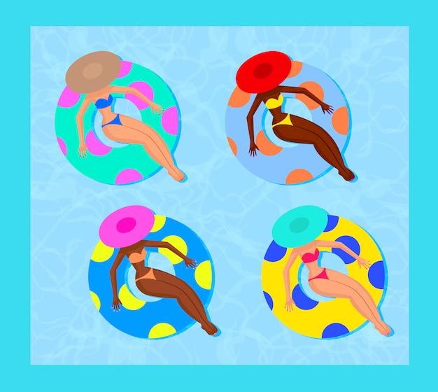 Cuatro mujeres de la piscina de verano se relajan en bikini en un flotador inflable de lunares