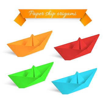 Cuatro origami de coloridas naves de papel.