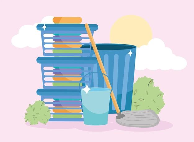 Cubo cestas de lavandería basura y trapeador delante del cielo
