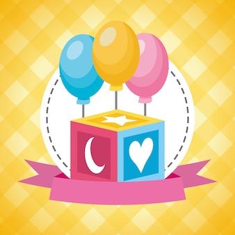 Cubo de juguete y globos para baby shower