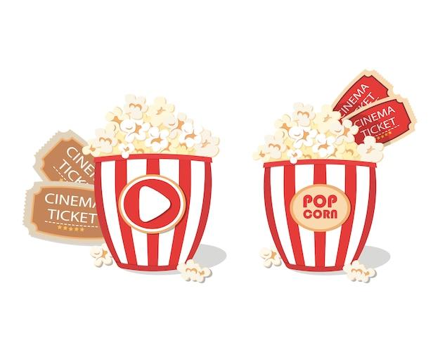 Cubo de palomitas de maíz y entradas de cine.