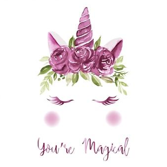 Cuernos de unicornio decorados con rosas moradas de acuarela.
