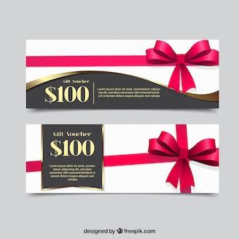 Cupones de regalo con cinta rosa decorativa