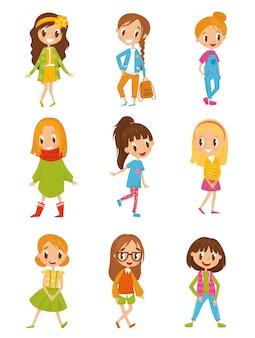 Cute dibujos animados chicas en ropa de moda set ilustraciones sobre un fondo blanco.