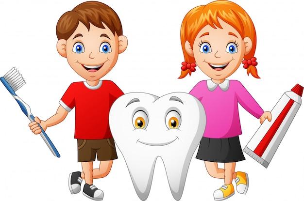 Cute dibujos animados niño, niña y dientes.