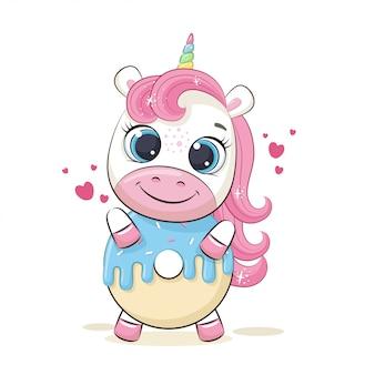 Cute dibujos animados unicornio manteniendo deliciosas donas