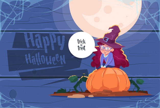 Cute kid wear witch costume sit on pumpkin, happy halloween party celebration concept