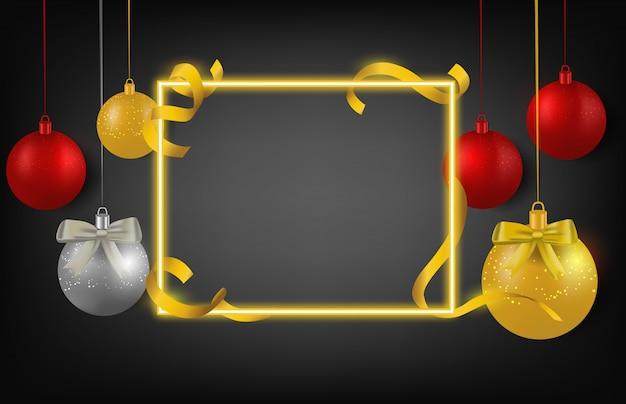 Decoraciones de navidad doradas bola de cinta y marco sobre fondo negro