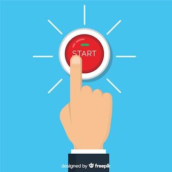 Dedo presionando botón de start