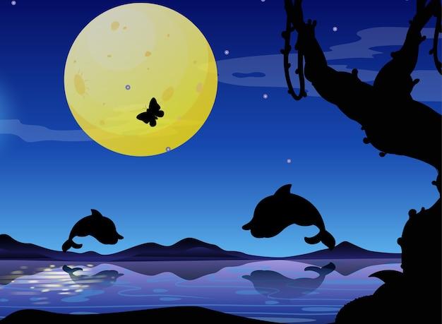 Delfín en silueta de escena de la naturaleza