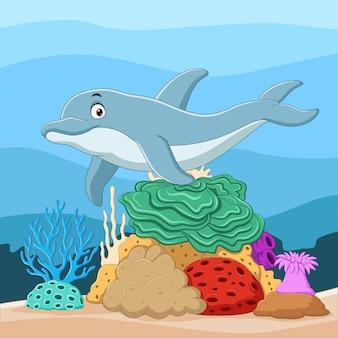 Delfines de dibujos animados con corales en mundo submarino