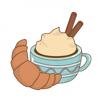 Deliciosa taza de chocolate con croissant.