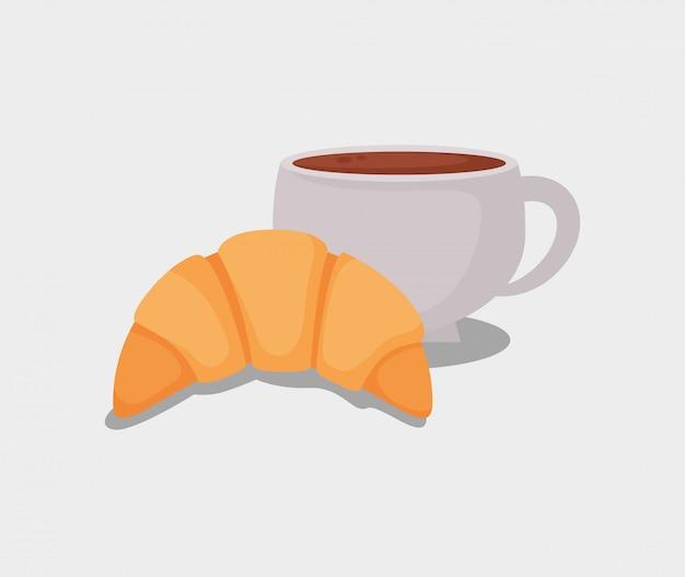 Delicioso pan de croissant y taza de café