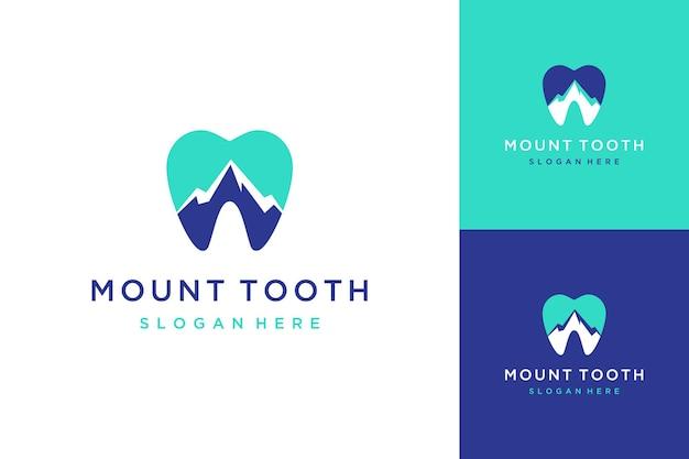 Dentista de diseño de logotipo en las montañas o dientes con una montaña