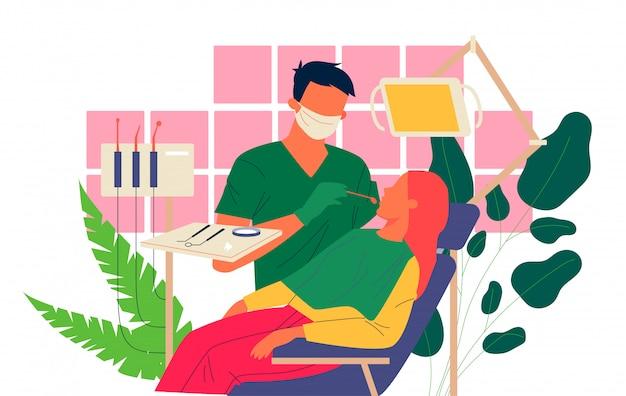Dentista examinando los dientes del paciente