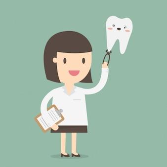 Dentista sujetando un diente