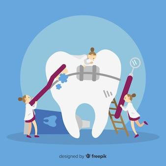 Dentistas cuidando un diente
