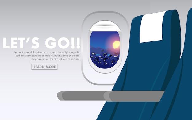 Dentro de la cabina del avión con asiento plano y ciudad nocturna en la ventana.