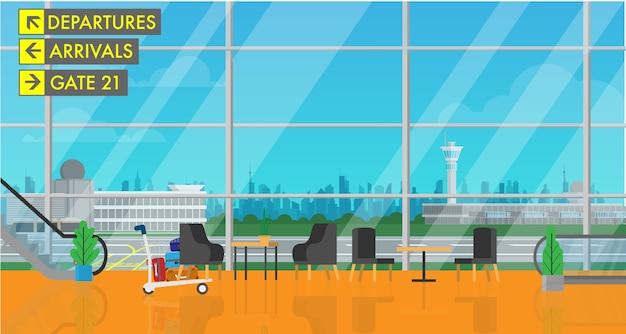 Dentro del edificio terminal del aeropuerto de salida con vista a la ciudad.