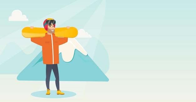 Deportista caucásico joven que sostiene los esquís.