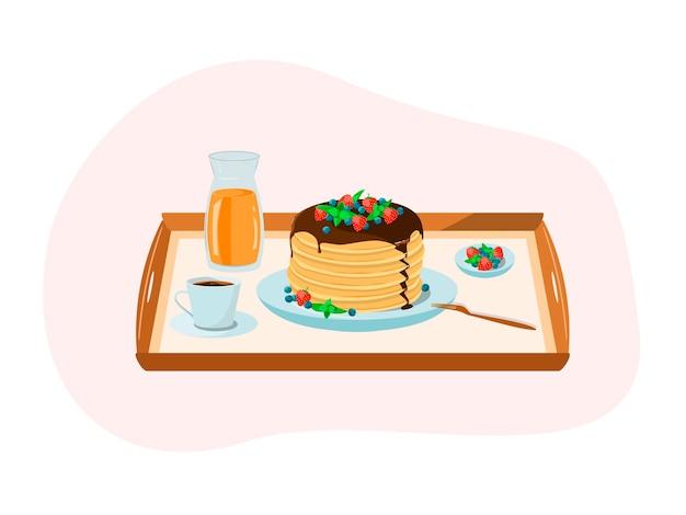 Desayuno en bandeja panqueques con frutos rojos café jugo de naranja