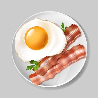 Desayuno inglés realista 3d - tocino sabroso, huevo frito con perejil verde en la placa blanca.