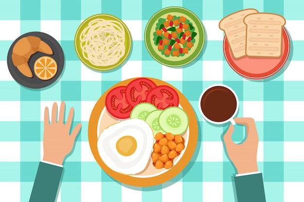 Desayuno que come la comida en las placas y la mano del hombre en la tabla.