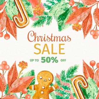 Descuento de venta de navidad en acuarela con hojas y hombre de jengibre