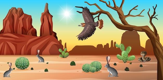 Desierto con montañas rocosas y paisaje de animales del desierto en la escena diurna