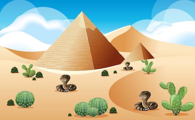 Desierto con paisaje de pirámides y serpientes de cascabel en la escena diurna