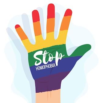 Detener la homofobia con la mano del arco iris