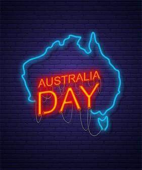 Dia de australia. muestra de neón en la pared de ladrillo. mapa de australia. feriado nacional australiano