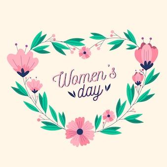 Día floral de la mujer con flores rosas y letras