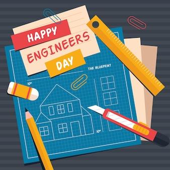 Día del ingeniero con planos y lapiz