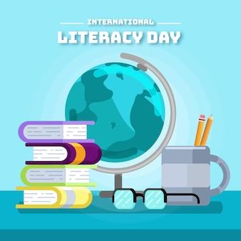 Día internacional de la alfabetización con globo y libros.