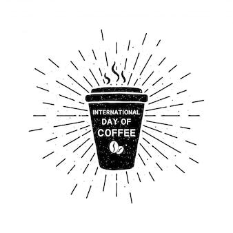 Día internacional del café con letras. ilustración vintage de vacaciones grunge con rayos de sol