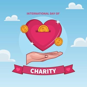 Día internacional de caridad con corazón y moneda.