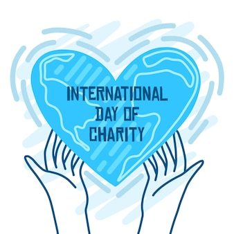 Día internacional de caridad manos sosteniendo un corazón