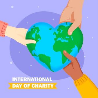 Día internacional de la caridad con manos y tierra en forma de corazón.