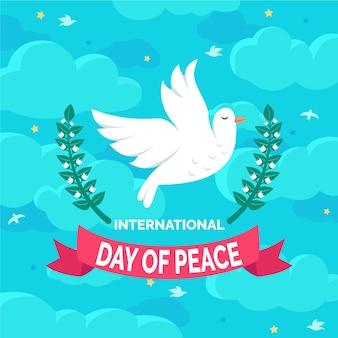 Día internacional de la paz con paloma y nubes.