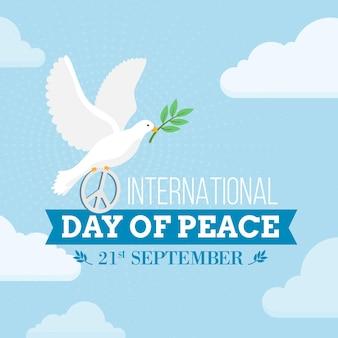 Día internacional de la paz con paloma y signo de la paz