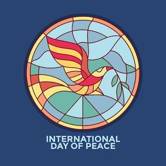 Día internacional de la paz con paloma y vidrieras