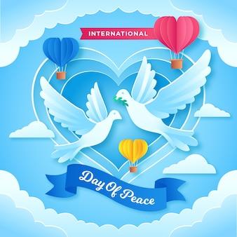 Día internacional de paz con palomas y corazón