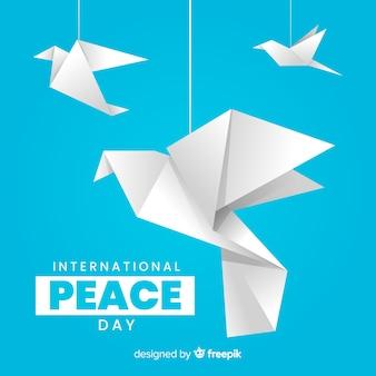 Día internacional de la paz con palomas de origami
