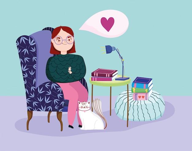 Día del libro, jovencita en el sofá con libros y gato