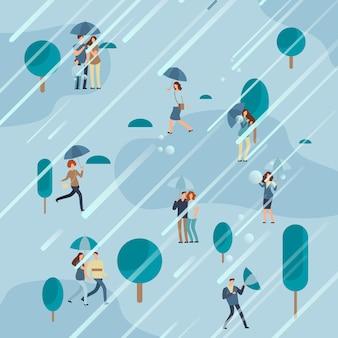 Día lluvioso en el parque con sombrillas de personas