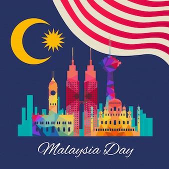 Día de malasia con bandera y edificio