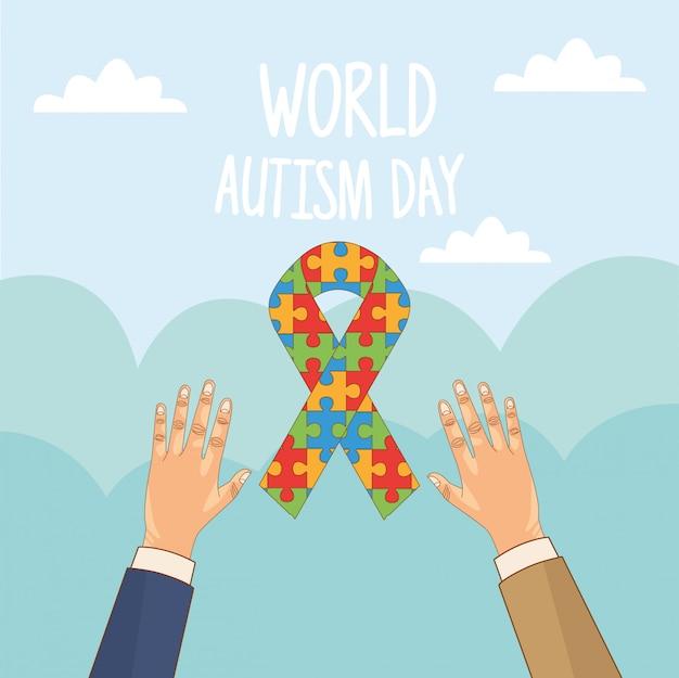 Día mundial del autismo con las manos levantando el rompecabezas de la cinta